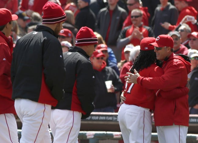 Apr 16, 2014; Cincinnati, OH, USA; Cincinnati Reds manager Bryan Price, far right, hugs starting pitcher Johnny Cueto (47) after the Reds defeated the Pittsburgh Pirates 4-0 at Great American Ball Park. Mandatory Credit: David Kohl-USA TODAY Sports