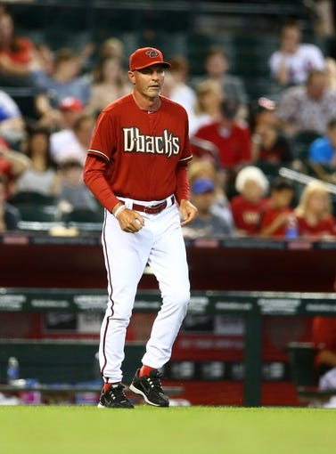 Apr 16, 2014; Phoenix, AZ, USA; Arizona Diamondbacks manager Kirk Gibson comes out to the mound in the sixth inning against the New York Mets at Chase Field. Mandatory Credit: Mark J. Rebilas-USA TODAY Sports