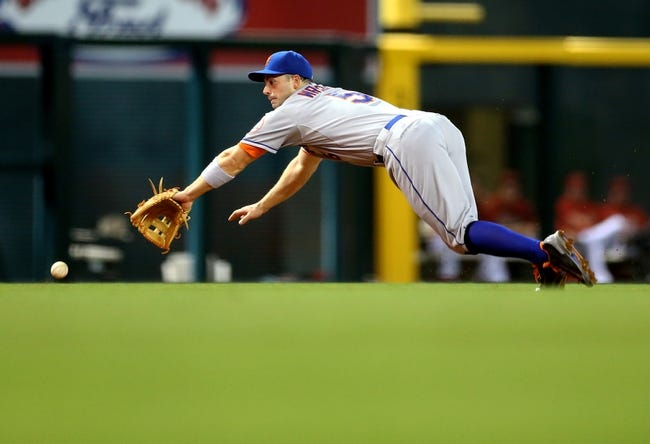 Apr 16, 2014; Phoenix, AZ, USA; New York Mets third baseman David Wright is unable to make a diving catch in the fifth inning against the Arizona Diamondbacks at Chase Field. Mandatory Credit: Mark J. Rebilas-USA TODAY Sports