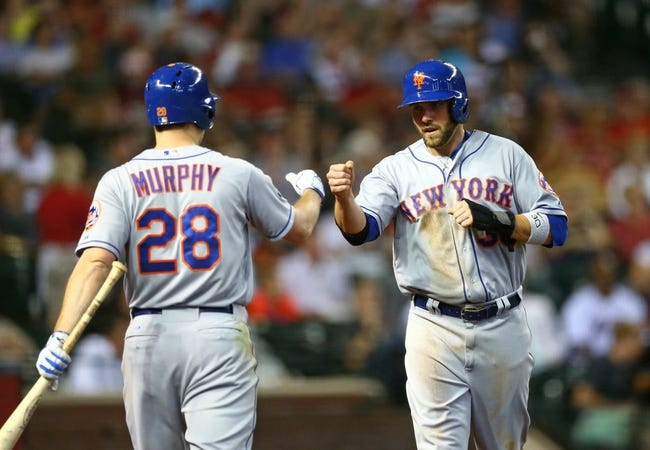 Apr 16, 2014; Phoenix, AZ, USA; New York Mets outfielder Andrew Brown (right) is congratulated by Daniel Murphy after scoring in the sixth inning against the Arizona Diamondbacks at Chase Field. Mandatory Credit: Mark J. Rebilas-USA TODAY Sports