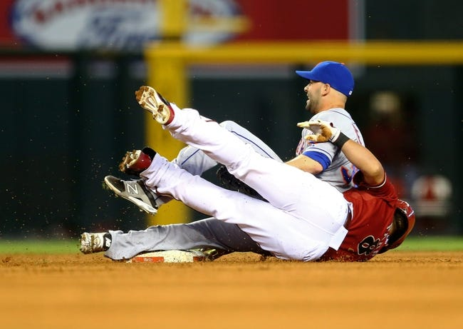 Apr 16, 2014; Phoenix, AZ, USA; New York Mets pitcher Dillon Gee (top) collides with Arizona Diamondbacks base runner Gerardo Parra after tagging him out in the sixth inning at Chase Field. Mandatory Credit: Mark J. Rebilas-USA TODAY Sports