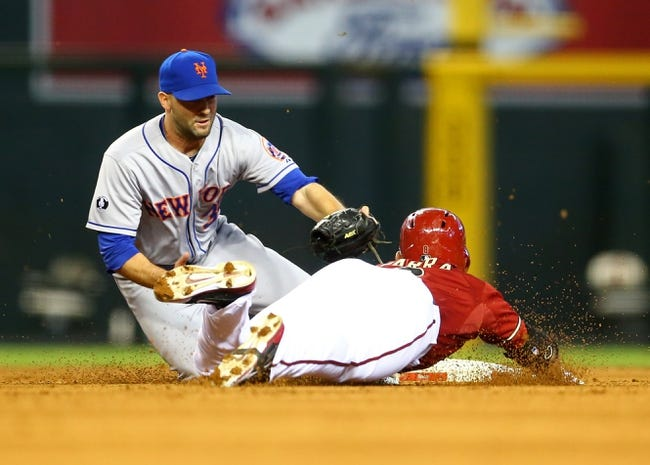 Apr 16, 2014; Phoenix, AZ, USA; New York Mets pitcher Dillon Gee (left) tags out Arizona Diamondbacks base runner Gerardo Parra in the sixth inning at Chase Field. Mandatory Credit: Mark J. Rebilas-USA TODAY Sports