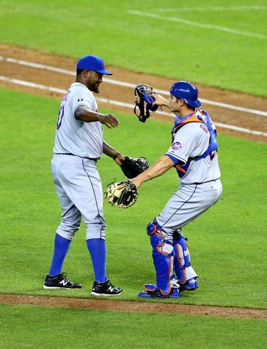 Apr 16, 2014; Phoenix, AZ, USA; New York Mets pitcher Jose Valverde (left) celebrates with catcher Anthony Recker following the final out of the game against the Arizona Diamondbacks at Chase Field. The Mets defeated the Diamondbacks 5-2. Mandatory Credit: Mark J. Rebilas-USA TODAY Sports