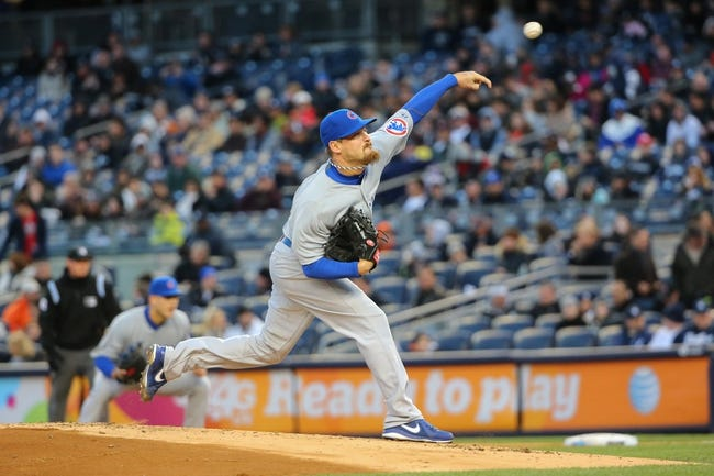 Apr 16, 2014; Bronx, NY, USA;  Chicago Cubs starting pitcher Travis Wood (37) delivers pitch during the first inning against the New York Yankees at Yankee Stadium. Mandatory Credit: Anthony Gruppuso-USA TODAY Sports