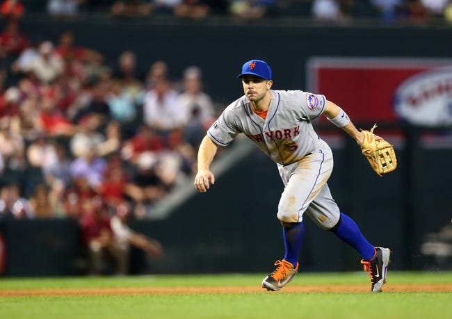 Apr 16, 2014; Phoenix, AZ, USA; New York Mets third baseman David Wright in the eighth inning against the Arizona Diamondbacks at Chase Field. The Mets defeated the Diamondbacks 5-2. Mandatory Credit: Mark J. Rebilas-USA TODAY Sports