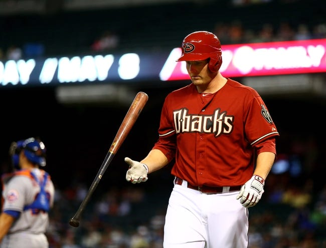 Apr 16, 2014; Phoenix, AZ, USA; Arizona Diamondbacks outfielder Mark Trumbo reacts after striking out in the ninth inning against the New York Mets at Chase Field. The Mets defeated the Diamondbacks 5-2. Mandatory Credit: Mark J. Rebilas-USA TODAY Sports