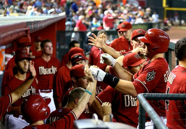 Apr 16, 2014; Phoenix, AZ, USA; Arizona Diamondbacks first baseman Paul Goldschmidt (right) is congratulated by teammates after hitting a home run in the ninth inning against the New York Mets at Chase Field. The Mets defeated the Diamondbacks 5-2. Mandatory Credit: Mark J. Rebilas-USA TODAY Sports