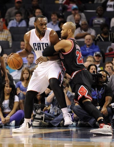 Apr 16, 2014; Charlotte, NC, USA; Charlotte Bobcats center Al Jefferson (25) looks to drive to the basket but is stopped by Chicago Bulls forward center Taj Gibson (22) during the first half of the game at Time Warner Cable Arena. Mandatory Credit: Sam Sharpe-USA TODAY Sports