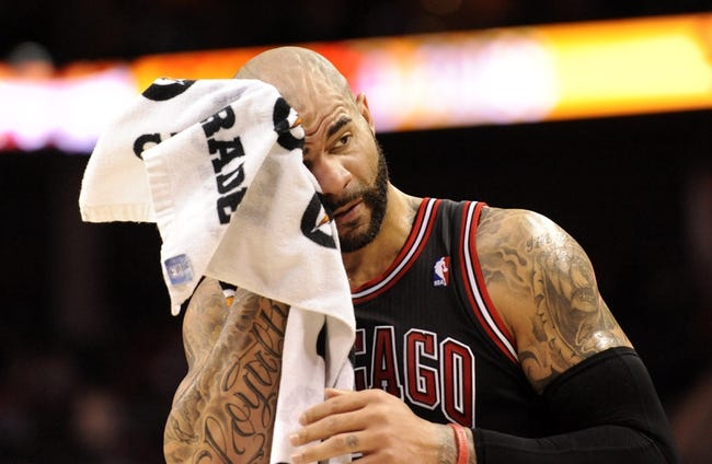 Apr 16, 2014; Charlotte, NC, USA; Chicago Bulls forward Carlos Boozer (5) wipes his head during a time out during the first half of the game against the Charlotte Bobcats at Time Warner Cable Arena. Mandatory Credit: Sam Sharpe-USA TODAY Sports