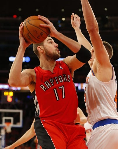 Apr 16, 2014; New York, NY, USA;  Toronto Raptors center Jonas Valanciunas (17) drives to the basket during the first half against New York Knicks center Cole Aldrich (45) at Madison Square Garden. Mandatory Credit: Jim O'Connor-USA TODAY Sports