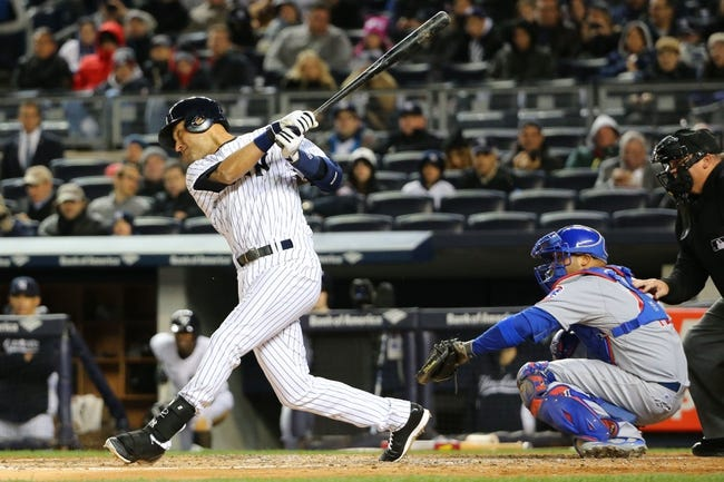 Apr 16, 2014; Bronx, NY, USA;  New York Yankees shortstop Derek Jeter (2) at bat getting a double on an error during the third inning against the Chicago Cubs at Yankee Stadium. Mandatory Credit: Anthony Gruppuso-USA TODAY Sports