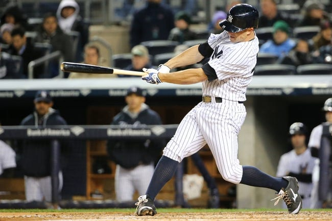 Apr 16, 2014; Bronx, NY, USA;  New York Yankees left fielder Brett Gardner (11) singles to right allowing a runner to score during the fourth inning against the Chicago Cubs at Yankee Stadium. Mandatory Credit: Anthony Gruppuso-USA TODAY Sports
