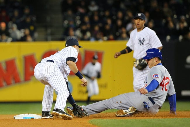 Apr 16, 2014; Bronx, NY, USA;  Chicago Cubs first baseman Anthony Rizzo (44) is caught stealing by New York Yankees shortstop Derek Jeter (2) during the fourth inning at Yankee Stadium. Mandatory Credit: Anthony Gruppuso-USA TODAY Sports