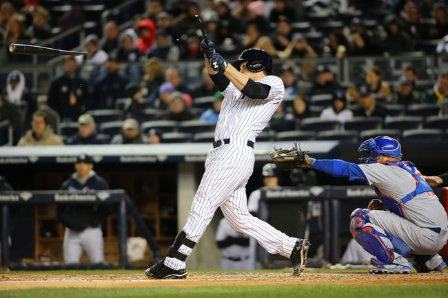 Apr 16, 2014; Bronx, NY, USA;New York Yankees catcher John Ryan Murphy (66) hits a broken bat single to left center advancing a man during the fourth inning against the Chicago Cubs at Yankee Stadium. Mandatory Credit: Anthony Gruppuso-USA TODAY Sports
