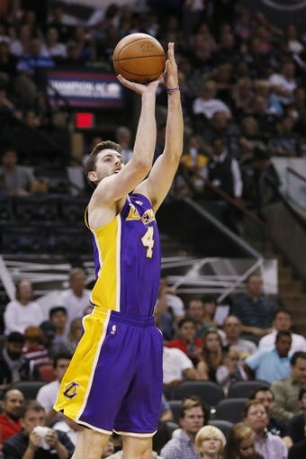Apr 16, 2014; San Antonio, TX, USA; Los Angeles Lakers forward Ryan Kelly (4) shoots the ball during the first half against the San Antonio Spurs at AT&T Center. Mandatory Credit: Soobum Im-USA TODAY Sports