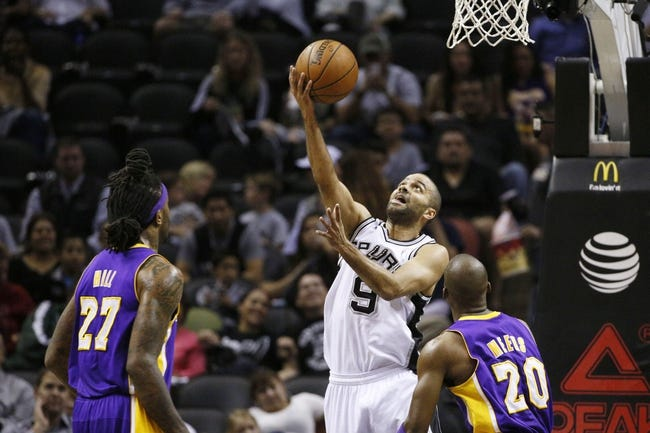 Apr 16, 2014; San Antonio, TX, USA; San Antonio Spurs guard Tony Parker (9) shoots as Los Angeles Lakers forward Jordan Hill (27) and guard Jodie Meeks (20) look on during the first half at AT&T Center. Mandatory Credit: Soobum Im-USA TODAY Sports