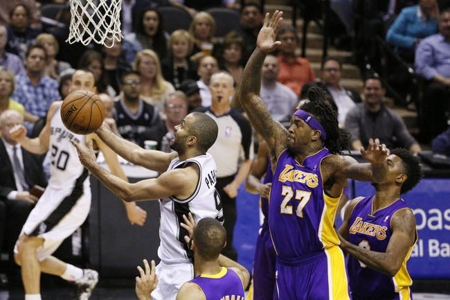 Apr 16, 2014; San Antonio, TX, USA; San Antonio Spurs guard Tony Parker (9) shoots the ball past Los Angeles Lakers forward Jordan Hill (27) during the first half at AT&T Center. Mandatory Credit: Soobum Im-USA TODAY Sports