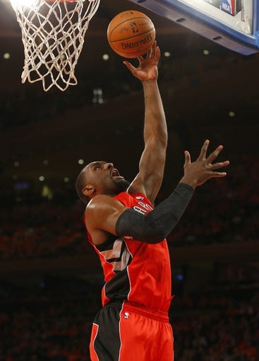 Apr 16, 2014; New York, NY, USA;  Toronto Raptors forward Patrick Patterson (54) drives to the basket during the first half against the New York Knicks at Madison Square Garden. Mandatory Credit: Jim O'Connor-USA TODAY Sports
