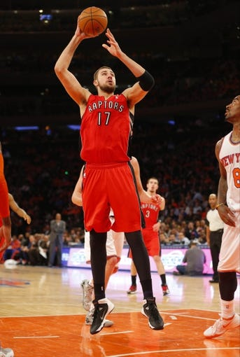 Apr 16, 2014; New York, NY, USA;  Toronto Raptors center Jonas Valanciunas (17) gets off a jump shot against New York Knicks at Madison Square Garden. Mandatory Credit: Jim O'Connor-USA TODAY Sports