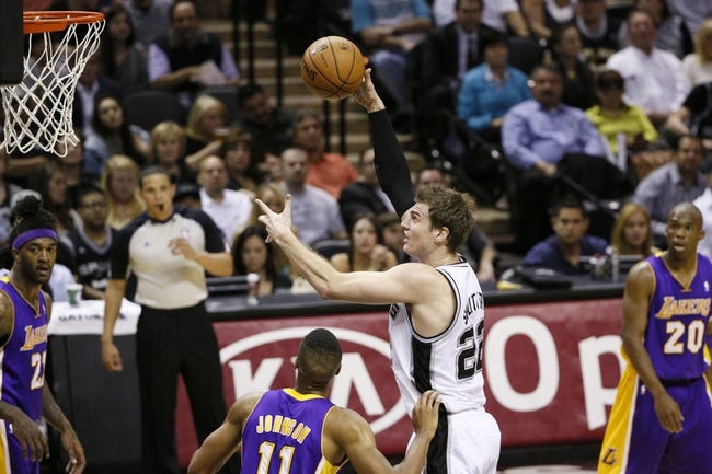 Apr 16, 2014; San Antonio, TX, USA; San Antonio Spurs forward Tiago Splitter (22) shoots the ball over Los Angeles Lakers forward Wesley Johnson (11) during the first half at AT&T Center. Mandatory Credit: Soobum Im-USA TODAY Sports