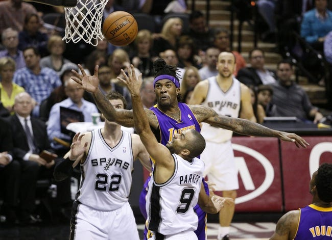 Apr 16, 2014; San Antonio, TX, USA; Los Angeles Lakers forward Jordan Hill (27) shoots against the San Antonio Spurs defense during the first half at AT&T Center. Mandatory Credit: Soobum Im-USA TODAY Sports