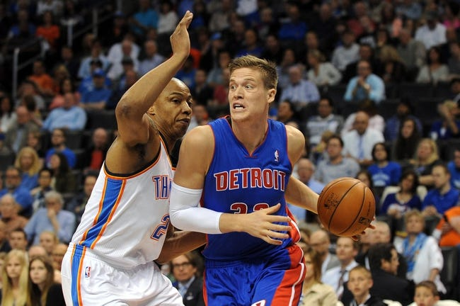 Apr 16, 2014; Oklahoma City, OK, USA; Detroit Pistons forward Kyle Singler (25) drives to the basket against Oklahoma City Thunder forward Caron Butler (2) during the second quarter  at Chesapeake Energy Arena. Mandatory Credit: Mark D. Smith-USA TODAY Sports