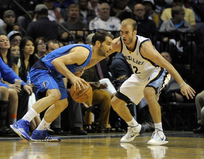 Apr 16, 2014; Memphis, TN, USA; Dallas Mavericks guard Jose Calderon (8) handles the ball against Memphis Grizzlies guard Nick Calathes (12) during the game at FedExForum. Mandatory Credit: Justin Ford-USA TODAY Sports