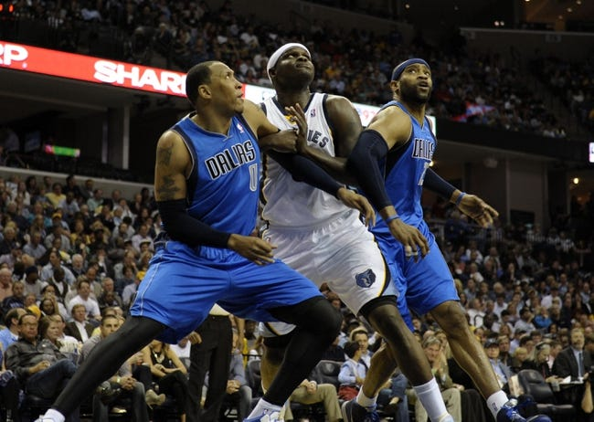 Apr 16, 2014; Memphis, TN, USA; Dallas Mavericks forward Shawn Marion (0) and Dallas Mavericks guard Vince Carter (25) box out Memphis Grizzlies forward Zach Randolph (50) during the game at FedExForum. Mandatory Credit: Justin Ford-USA TODAY Sports