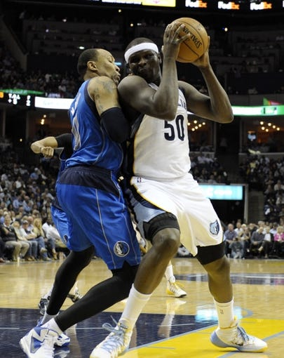 Apr 16, 2014; Memphis, TN, USA; Memphis Grizzlies forward Zach Randolph (50) handles the ball against Dallas Mavericks forward Shawn Marion (0) during the game at FedExForum. Mandatory Credit: Justin Ford-USA TODAY Sports