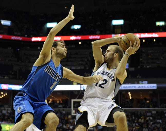 Apr 16, 2014; Memphis, TN, USA; Dallas Mavericks guard Jose Calderon (8) guards Memphis Grizzlies guard Nick Calathes (12) during the game at FedExForum. Mandatory Credit: Justin Ford-USA TODAY Sports
