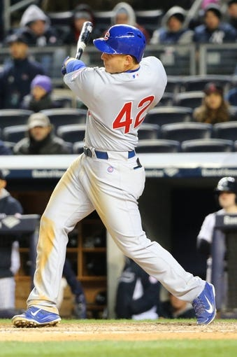 Apr 16, 2014; Bronx, NY, USA;  Chicago Cubs first baseman Anthony Rizzo (44) triples to right during the sixth inning against the New York Yankees at Yankee Stadium. Mandatory Credit: Anthony Gruppuso-USA TODAY Sports