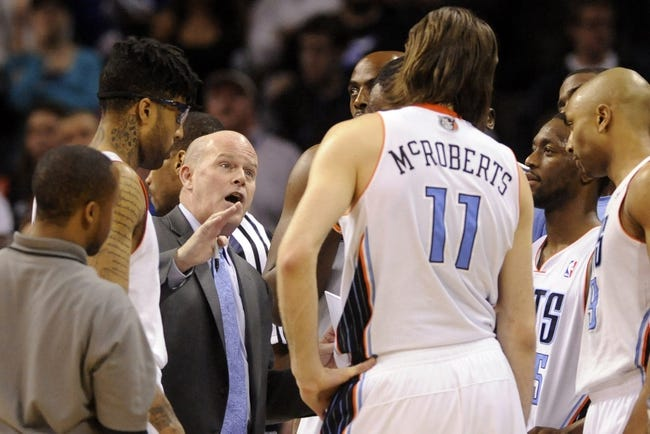 Apr 16, 2014; Charlotte, NC, USA; Charlotte Bobcats head coach Steve Clifford talks to his team in a time out during the second half of the game against the Chicago Bulls at Time Warner Cable Arena. Bobcats win in overtime 91-86. Mandatory Credit: Sam Sharpe-USA TODAY Sports