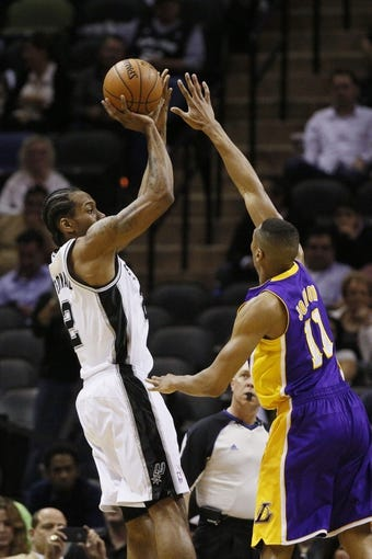 Apr 16, 2014; San Antonio, TX, USA; San Antonio Spurs forward Kawhi Leonard (2) shoots the ball over Los Angeles Lakers forward Wesley Johnson (11) during the first half at AT&T Center. Mandatory Credit: Soobum Im-USA TODAY Sports