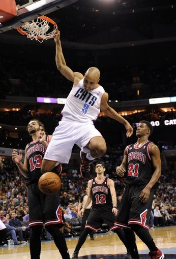 Apr 16, 2014; Charlotte, NC, USA; Charlotte Bobcats guard Gerald Henderson (9) drives past the Chicago Bulls defense of center Joakim Noah (13), guard forward Jimmy Butler (21) and guard Kirk Hinsich (12) during the second half of the game at Time Warner Cable Arena. Bobcats win in overtime 91-86. Mandatory Credit: Sam Sharpe-USA TODAY Sports