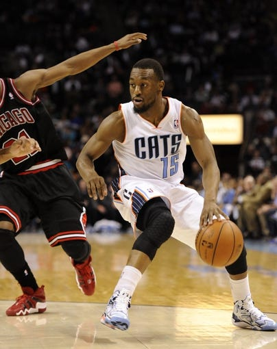 Apr 16, 2014; Charlotte, NC, USA; Charlotte Bobcats guard Kemba Walker (15) during the second half of the game against the Chicago Bulls at Time Warner Cable Arena. Bobcats win in overtime 91-86. Mandatory Credit: Sam Sharpe-USA TODAY Sports
