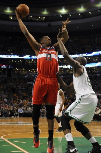 Apr 16, 2014; Boston, MA, USA; Washington Wizards center Kevin Seraphin (13) shoots the ball over Boston Celtics center Joel Anthony (50) during the second half at TD Garden. Mandatory Credit: Bob DeChiara-USA TODAY Sports