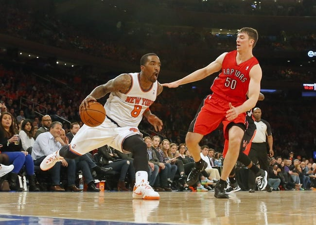 Apr 16, 2014; New York, NY, USA;  New York Knicks guard J.R. Smith (8) handles the ball against Toronto Raptors forward Tyler Hansbrough (50) during the second half at Madison Square Garden. New York Knicks defeat the Toronto Raptors 95-92. Mandatory Credit: Jim O'Connor-USA TODAY Sports