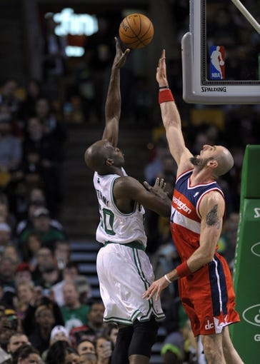 Apr 16, 2014; Boston, MA, USA; Boston Celtics center Joel Anthony (50) shoots the ball over Washington Wizards center Marcin Gortat (4) during the second half at TD Garden. Mandatory Credit: Bob DeChiara-USA TODAY Sports