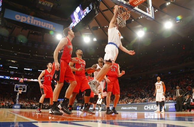 Apr 16, 2014; New York, NY, USA;  New York Knicks center Cole Aldrich (45) drives to the basket for a dunk during the second half against the Toronto Raptors at Madison Square Garden. New York Knicks defeat the Toronto Raptors 95-92. Mandatory Credit: Jim O'Connor-USA TODAY Sports