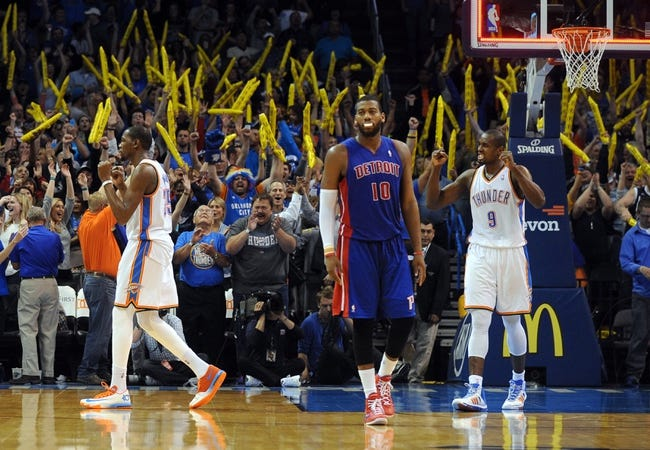 Apr 16, 2014; Oklahoma City, OK, USA;  Oklahoma City Thunder forward Kevin Durant (35) and Oklahoma City Thunder forward Serge Ibaka (9) celebrate after the Thunder beat the Detroit Pistons at Chesapeake Energy Arena. The Thunder defeated the Pistons 112-111. Mandatory Credit: Mark D. Smith-USA TODAY Sports