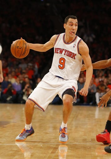 Apr 16, 2014; New York, NY, USA;  New York Knicks guard Pablo Prigioni (9) brings the ball up court during the second half against the Toronto Raptors at Madison Square Garden. New York Knicks defeat the Toronto Raptors 95-92. Mandatory Credit: Jim O'Connor-USA TODAY Sports
