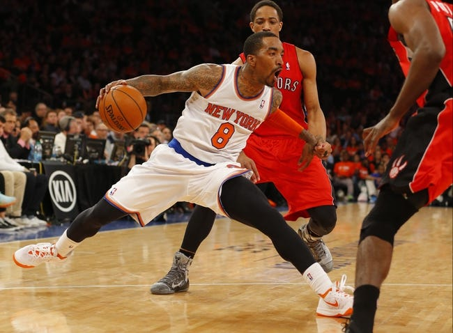 Apr 16, 2014; New York, NY, USA;  New York Knicks guard J.R. Smith (8) handles the ball during the second half against the Toronto Raptors at Madison Square Garden. New York Knicks defeat the Toronto Raptors 95-92. Mandatory Credit: Jim O'Connor-USA TODAY Sports