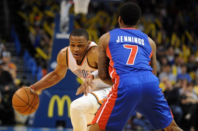Apr 16, 2014; Oklahoma City, OK, USA;  Oklahoma City Thunder guard Russell Westbrook (0) drives to the basket against Detroit Pistons guard Brandon Jennings (7) during the fourth quarter at Chesapeake Energy Arena. Mandatory Credit: Mark D. Smith-USA TODAY Sports