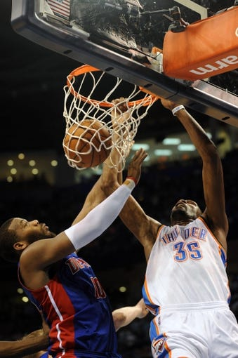 Apr 16, 2014; Oklahoma City, OK, USA;  Oklahoma City Thunder forward Kevin Durant (35) dunks the ball against Detroit Pistons forward Greg Monroe (10) during the fourth quarter at Chesapeake Energy Arena. Mandatory Credit: Mark D. Smith-USA TODAY Sports