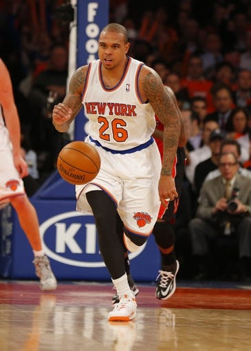 Apr 16, 2014; New York, NY, USA;  New York Knicks guard Shannon Brown (26) brings the ball up court during the second half against the Toronto Raptors at Madison Square Garden. New York Knicks defeat the Toronto Raptors 95-92. Mandatory Credit: Jim O'Connor-USA TODAY Sports