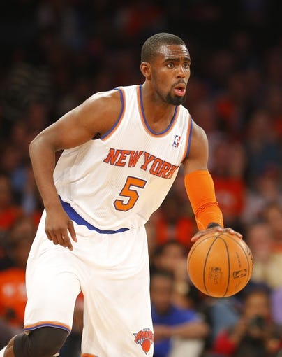 Apr 16, 2014; New York, NY, USA;  New York Knicks guard Tim Hardaway Jr. (5) brings the ball up court during the second half against the Toronto Raptors at Madison Square Garden. New York Knicks defeat the Toronto Raptors 95-92. Mandatory Credit: Jim O'Connor-USA TODAY Sports