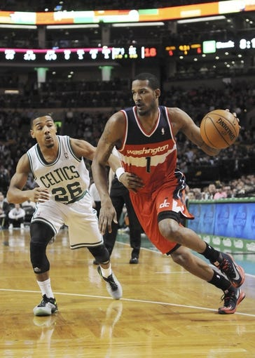 Apr 16, 2014; Boston, MA, USA; Washington Wizards forward Trevor Ariza (1) controls the ball while being defended by Boston Celtics guard Phil Pressey (26) during the first half at TD Garden. Mandatory Credit: Bob DeChiara-USA TODAY Sports