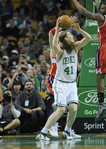 Apr 16, 2014; Boston, MA, USA; Boston Celtics center Kelly Olynyk (41) grabs a rebound during the first half against the Washington Wizards at TD Garden. Mandatory Credit: Bob DeChiara-USA TODAY Sports
