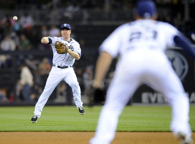 Apr 16, 2014; San Diego, CA, USA; San Diego Padres second baseman Jedd Gyorko (9) fields a ground ball in shallow right field for an out during the fourth inning against the Colorado Rockies at Petco Park. Mandatory Credit: Christopher Hanewinckel-USA TODAY Sports