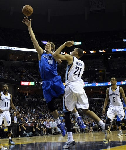Apr 16, 2014; Memphis, TN, USA; Dallas Mavericks forward Dirk Nowitzki (41) shoots against Memphis Grizzlies forward Tayshaun Prince (21) during the game at FedExForum. Memphis Grizzlies beat the Dallas Mavericks in overtime 106 - 105. Mandatory Credit: Justin Ford-USA TODAY Sports
